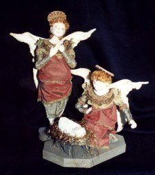 "A Gathering of Angels  Air dry clay is used to enhance the needlesculpted facial features of these exquisite 16"" painted muslin angels with Christ Child."