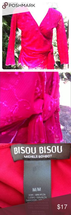 Mock wrap top in fushia Mock wrap , ties at the side if waist with self fabric tie... Fabric is embroideries on knit mesh fabric...3/4 sleeve, deep V , neck, lined,flutter edge at sleeve and hem... A 'Kristens Find' posh on girlfriend;) Bisou Bisou Tops Blouses