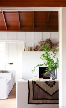 Love the white walls and stained wood vaulted ceilings with neutral decor . . .