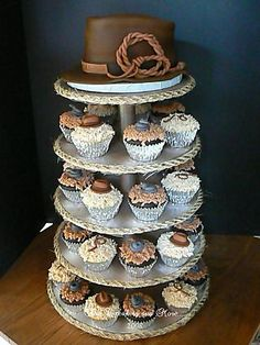the cake was made to look like the indiana jones hat along with his