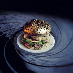 "This Wild Burger Art Is Actually Edible - Paris designers are behind 'Fat & Furious Burger';  a whacked-out, culinary-slash-photo Tumblr devoted to ""creazy"" (the designers' word) but edible burgers. - pictured:  ""Bun, James Bun."" A Goldeneye-inspired burger : Food Republic - Mar 3, 2015"