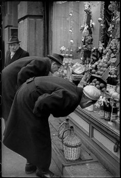 Henri Cartier-Bresson // Hungary, 1964 - Budapest. Purchase of wine for Christmas midnight supper.