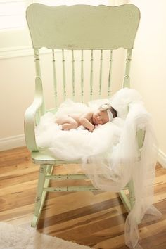 akupofkatie: Ireland's newborn photo shoot and nursery!I love the tulle and the green chair for a nurserey