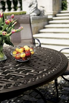 This dining table is cast aluminum with the exclusive Garden Terrace design.