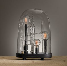 Chemistry Cloche from Restoration Hardware - about $600 (EEK. Really cool, though!)