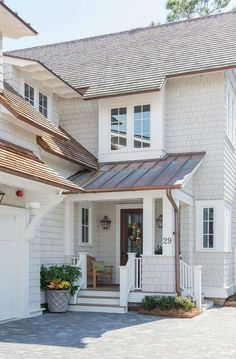 Repose Gray by Sherwin Williams. Exterior Colors. The shingles are stained in an acrylic, Repose Gray by Sherwin Williams. #ReposeGraySherwinWilliams #exteriorpaintcolor #homeExterior Interiors by Courtney Dickey of TS Adams Studio.