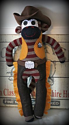 Cowboy Sock Monkey customs available at http://www.etsy.com/shop/KaysQuirkyCreations