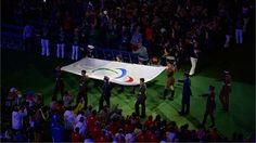 The Paralympic Flag is carried during the Closing Ceremony of London 2012