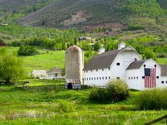 big flag on white barn!