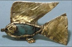 Egyptian amulet A gold fish pendant, with a coloured stone as its body. This example is now in the British Museum in London.