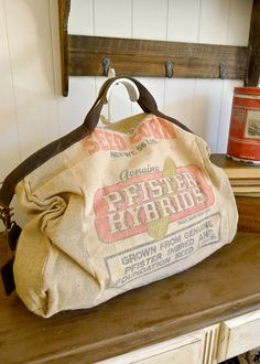 SALE - Pfister Seeds, Illinois- Vintage Seed Feed Sack Messenger Bag- Americana OOAK Canvas & Leather Tote... Selina Vaughan Studios. $85.00, via Etsy.