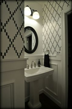 Black and White stenciled powder room with molding.  Learn how!