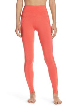 Adding a pop of coral to the workout gear with these high waisted leggings.