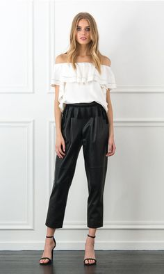 A key silhouette this season, the Gaia off-the-shoulder top is crafted from a lustrous satin-crepe. This easy-to-wear silhouette is designed with a ruffled overlay and cascading ruffles down the sides for a romantic and bohemian touch. Dress it up or down with jeans and lace up flats or wide leg silk trousers and heels.