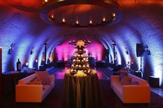 Colorful uplights create a spectacularly illuminated cave with Bliss Event Productions. at Napa Valley's Calistoga Ranch. Photo by Sherman Chu Photography. Lighting Design by Got Light.