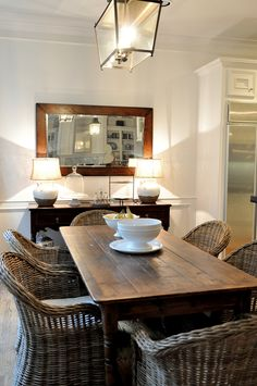 In the breakfast room, we added the curtains – four panels to fit in the long bay window with its six windows. The table was the client's, but we changed out her country French chairs for Kooboos from World Market.