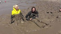 Jessie and Miah--muddy Rainwear: wellies and rainwear in thick mud