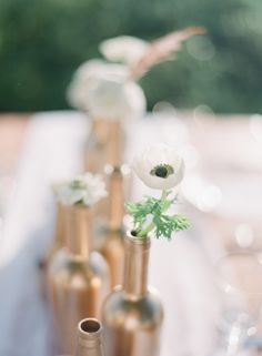 metallic painted bottles (Photo Captured by Jessica Lorren Organic Photography via Every Last Detail)