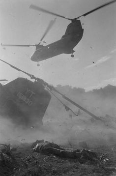 Dust, debris and smoke fill the air after a U.S. Marine CH-46 Sea Knight helicopter crashed while landing in the Song Ngan Valley, a short distance from the demilitarized zone between north and south Vietnam, July 18, 1966. Above another helicopter tries to get into the landing zone.  / Credit: AP Photo/Horst Faas
