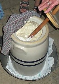 Making homemade butter with a butter churn.  I could spend some time on this website.