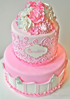 A Pretty Pink Cake. Would be perfect for my daughter's First Communion cake (but with a cross on top not flowers).