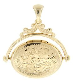 """This interesting 14K yellow gold antique style locket features a hinged, rotating photo compartment. An intricate floral design covers one side of the locket while a simple design covers the other. The locket measures 1 1/4"""" by 1""""."""
