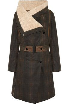 Karl Donoghueshearling-lined waxed cotton jacket is weatherproof. Shearling and leather trims and a warm wool lining ensure this heritage-inspired design is as cozy as it is cool. I'm gonna throw it over dark denim and leather ankle boots to tackle crisp fall mornings in style.