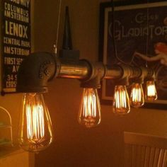 Not wood, but so very industrial and cool! DIY Industrial Vintage Look 5 light Edison Bulb Iron Pipe Chandelier Industrial Pipe, Industrial Lighting, Vintage Lighting, Vintage Industrial, Industrial Style, Industrial Chandelier, Design Industrial, Industrial Apartment, Edison Chandelier