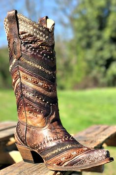 These gorgeous Brown Embroidered and Studs Boot by Corral feature a chevron mix of braids, studs, leathers, and embroidery. The intricate detailing on this boot is stunning! #southernfriedchics #corral