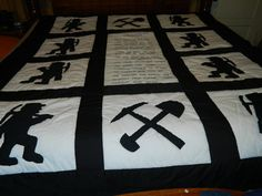 """This is a handmade, hand quilted coal miner's prayer quilt. Applique is machine done for durability. This quilt is queen size but is pictured on a king size bed. Picture blocks are approx. 18""""x18"""". Prayer is hand embroidered in the center. Backing is done with a very pretty black and white pattern. Quilt is made with cotton/polyester blend fabric. I live in coal country and I have never seen another one like it!"""