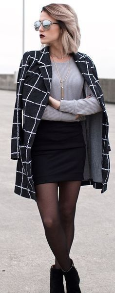 Grey sweater, black skirt, checked coat and ankle boots