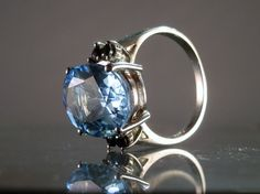 Hey, I found this really awesome Etsy listing at http://www.etsy.com/listing/157483022/blue-topaz-sapphire-and-sterling-silver
