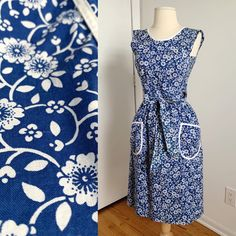 """New in Etsy! 1960s wrap apron dress. Original owner altered the bodice to fit her petite chest, about a b30"""". The stitches look like it can be easily reversed back to fit original 32-34"""" bust. Sold as is. 💙 1960s Kitchen, Apron Dress, One Piece Dress, One Piece For Women, Dress Form, Printed Cotton, Stitches, Bodice, Floral Prints"""