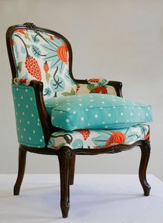Amazing how just the right fabric can completely change something into a beautiful piece of art.  The colors, the style, the fabric make for a perfect chair.