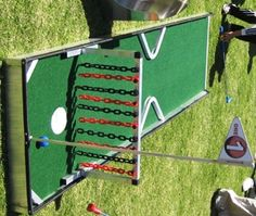 Miniature Golf Game with Chains as Obstacles