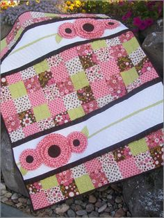 adorable baby girl quilt!!! pdf pattern $9.00. I would probably take the flowers off of the top and applique the child's name in that strip