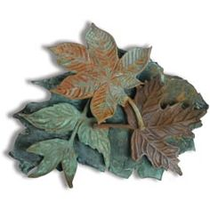 United Art and Education Art Project:  Rubbing plates work really well with clay!  Make a realistic-looking leaf collage with air-dry clay and paint it with real metal paint and patinas.