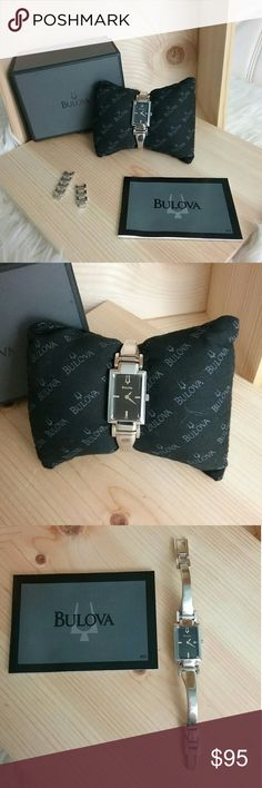 Women's Bulova watch GREAT CONDITION  Worn a few times  Has a couple very tiny scratches on the band  Everything pictured is included   Don't Forget to Bundle & Save!!! Bulova Accessories Watches