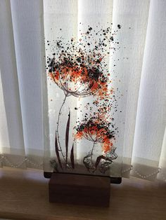 Each of my seedhead panels are designed and fired in my studio in the beautiful Scottish Borders where inspiration is endless. This panel is made using clear, red and black bullseye glass with copper inclusions which helps develop the interesting bubbles that make this item so unique,