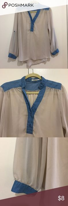 """Cream Blouse with Chambray Detail EUC, I love this but I just don't wear it enough. Cream color with chambray inserts. Sleeves can be worn down or buttoned up as shown. Sheer, need cami or bralette. Slightly longer in back than in front. Bust 19.5"""" flat, length in back 27"""", length in front 25"""". Looks great with leggings. Poetry Tops Blouses"""