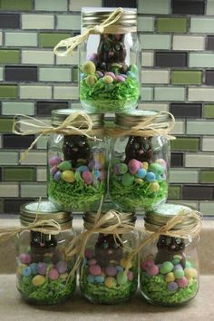 Easter - chocolate rabbit in a coconut nest with eggs, all in a Mason jar with raffia ribbon. Cute gift!