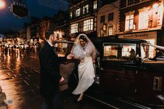 Groom helps his new bride out of vintage wedding car in chester city centre - grosvenor hotel