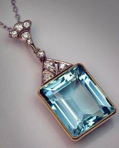 Vintage Jewelry Art Art Deco Russian Aquamarine Pendant emerald cut aquamarine x 14 x mm - approximately ct) in a yellow gold milgrain setting crowned by a triangular art deco style diamond-set mount and a plume shaped diamond bail. Art Deco Jewelry, Jewelry Gifts, Jewelry Accessories, Fine Jewelry, Jewelry Design, Gold Jewelry, Turquoise Jewelry, Jewlery, Handmade Jewelry
