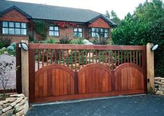 Cool Outdoor Sconce Lighting with Herringbone Pattern Driveway and Creative Wooden Gate Design Plus Exterior Brick Wall with Climbing Flower Plant Wood Fence Gate Designs, Wood Fence Gates, Wooden Gates, Fence Design, Patio Design, Fences, Gate For Home, Door Design Photos, Building A Gate