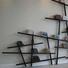 Mikado bookshelf, It's like your books are floating away from the wall.