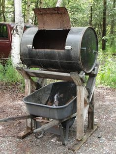 Living by Faith: Make your own compost tumbler. but use a plastic barrel