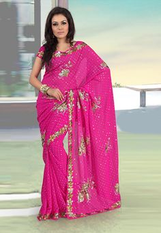 Dark pink faux georgette saree is embellished with sequins, zari and patch border. Matching readymade blouse is available. (Slight variation in color and patch border is possible.) data-pin-do=