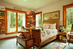 The bright Toy Room doubles as a guest room. Shelves hold discontinued All American Toy trucks; as a child, Bob Hamilton got the toys for Christmas when his father was given them in exchange for posting large billboards for a toy store in Kalispell, Montana. The vintage sleigh bed came from Karen Snyder's aunt.