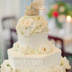 The two-tiered cake was covered in buttercream and lined with fresh flowers.