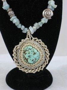 Turquoise Nugget surrounded by bead embroidery